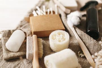 zero waste concept, sustainable lifestyle. plastic free natural eco bamboo toothbrush, coconut soap, handmade shampoo, crystal deodorant, luffa, bamboo ear sticks, brush © sonyachny