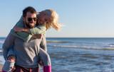 couple having fun at beach during autumn - 220710007
