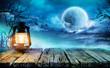 Leinwanddruck Bild - Halloween Lantern On Old Table In Spooky Night