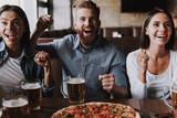 Handsome Smiling Friends Drinking Beer in Pub - 220727269