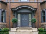 elegant front door with shrubbery