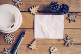Top view coffee cup and pen, blank paper on wood with christmas decoration for New year concept. - 220749053