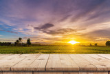Rice field sunset and Empty wood table for product display and montage. - 220749625