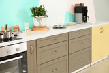 Modern kitchen furniture with electric stove - 220752053