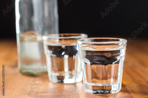 Fototapeta samoprzylepna Vodka in shot glass.