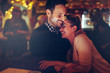 Romantic couple dating in pub at night - 220758659