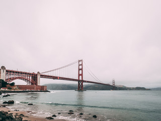 The golden gate bridge on a moody day © Steven