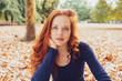 Attractive young redhead woman staring pensively