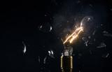 Freeze motion of old light bulb explosion on black backround - 220767434