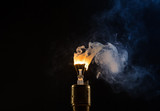 Burning old light bulb on black backround - 220767481