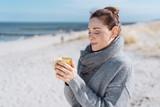 Young woman enjoying a relaxing cup of coffee - 220768668