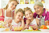 Portrait of a mom and daughters cook - 220771015
