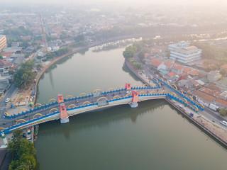 Hazy sky, aerial view of Berendeng Bridge, Tangerang, Indonesia. © AlexandraDaryl