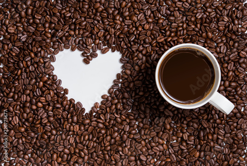 love of coffee, symbol of love, shape of heart from coffee beans with cup