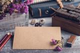 Craft envelope on rustic wooden background. - 220785256