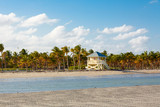 Beautiful Crandon Park Beach located in Key Biscayne in Miami, Florida, USA. Palms, white sand and security house - 220786062