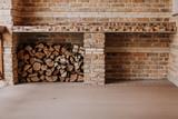 Firewood stacked in niche on veranda - 220786691