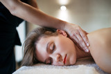 Stress relieving massage by therapist - 220791230