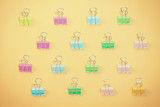 colorful binder clips on yellow background - 220795665