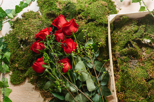 Red roses on green moss