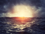 Sunset on stormy sea - 220816694