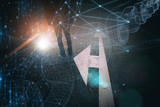 Blockchain business man stands alone on ashpalt road with intersection arrows signs and futuristic cyberspace network background. - 220825616