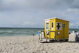 Cute bright yellow wooden cabin at beachside   Tiny house built on sand at seaside   Sylt, Germany  - 220832299