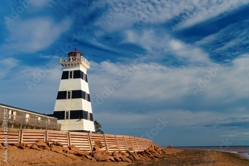 West Point Lighthouse along the shore of rural Prince Edward Island, Canada.