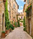 A narrow and picturesque street in Pienza, Tuscany, Italy. © e55evu