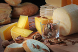 Hard cheeses of home production in assortment on a wooden background. The concept of still life. - 220863482