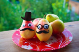 funny fruit portrait on a nature background - 220866060