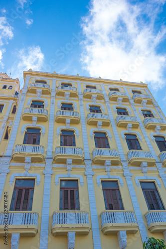 Historical house with cloudy sky, Havana, Cuba