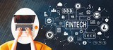 Cryptocurrency fintech theme with person using a laptop on a white table - 220895657