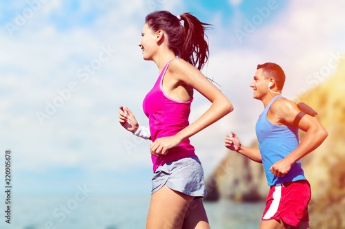 Fitness, sport, friendship and lifestyle concept - smiling