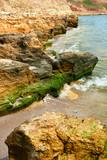 beautiful seaside landscape, closeup of stone on the beach, sea coast with high hills, wild nature - 220908672