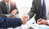 Men shaking hands with smile at office with their coworkers. - 220912413