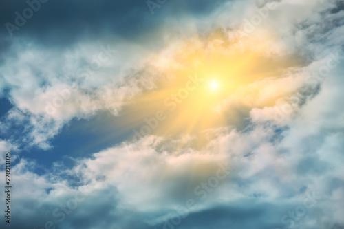 Foto Murales Rays of sun shining in blue sky.