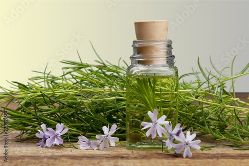Oil bottles and dry lavender flowers