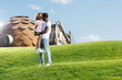 african american father holding daughter on hill at amusement park