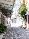 Narrow street with white houses, Greece - 220935629