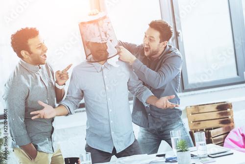 Naklejka portrait of young business team having fun in office, business teamwork