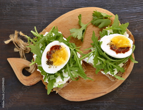Toast With Cream Cheese Arugula And Boiled Egg Healthy Breakfast Top View