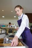 beautiful young friendly waitress - 220951840