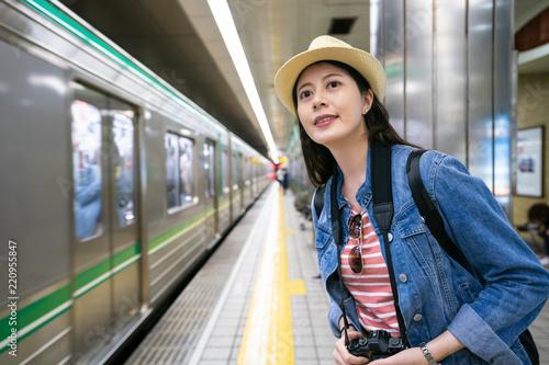 Fototapeta travle female waiting for her train coming
