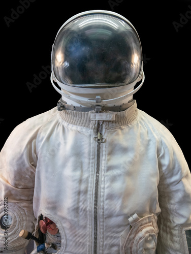 Soviet cosmonaut or astronaut or spaceman suit and helmet on black background - 220957212
