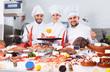 Leinwanddruck Bild - Chefs offering seafood in restaurant