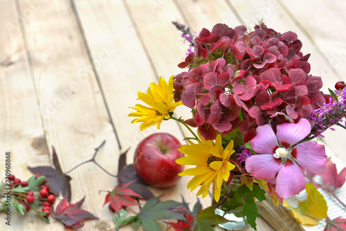 beautiful colors of autumnal flowers on wooden background - 220968868
