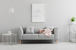 Leinwanddruck Bild - Poster above grey sofa with pink blanket in living room interior with white lamp and plant. Real photo