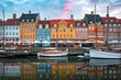 Leinwanddruck Bild - Nyhavn at sunrise, with colorful facades of old houses and old ships in the Old Town of Copenhagen, capital of Denmark.