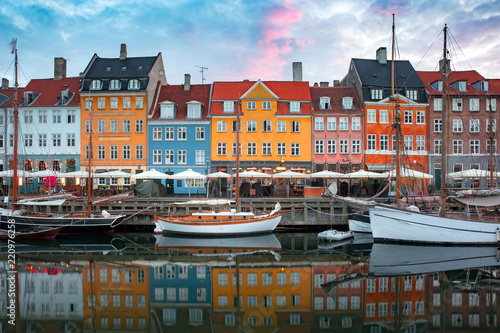 Leinwanddruck Bild Nyhavn at sunrise, with colorful facades of old houses and old ships in the Old Town of Copenhagen, capital of Denmark.